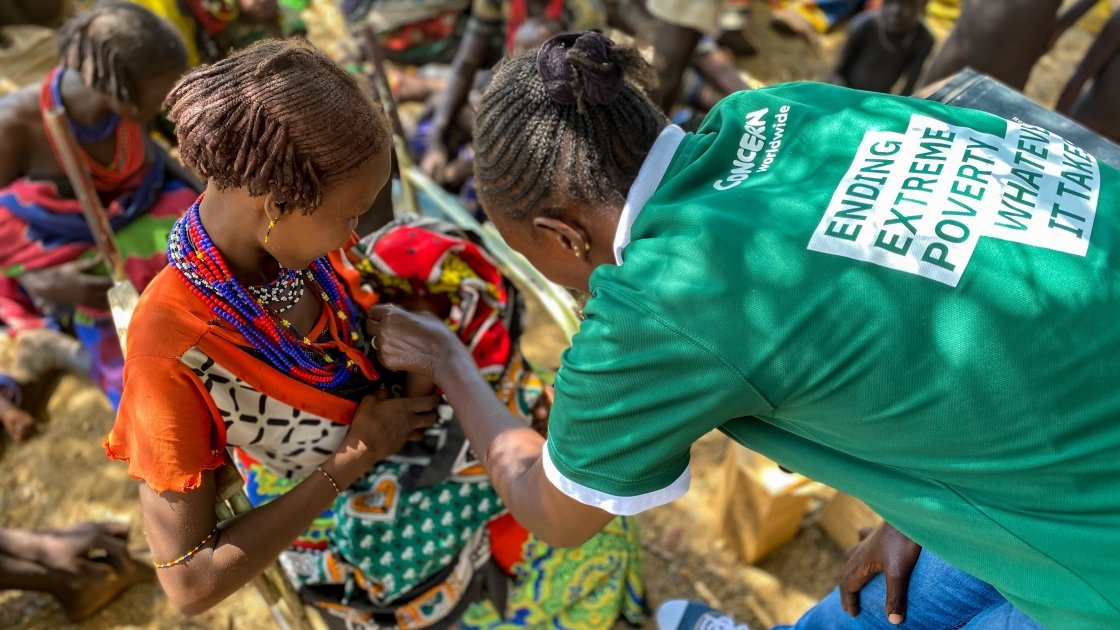Concern nurse Beatrice welcomes mothers and children at an outreach centre in rural Kenya. Photo: Jennifer Nolan
