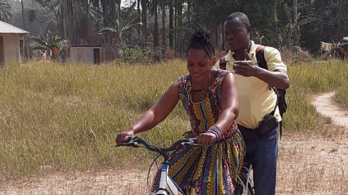 Influential Woman in Sierra Leone having a cycling lesson.