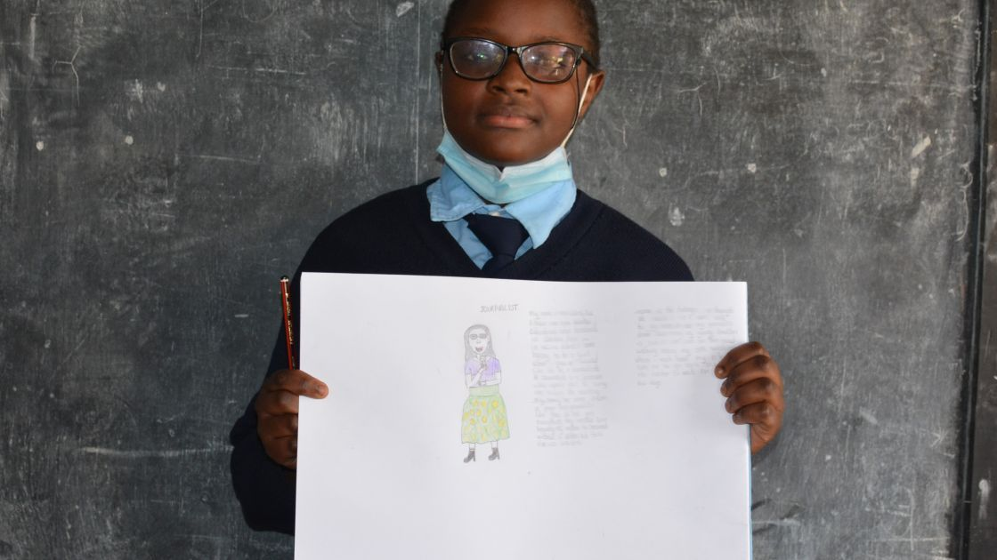 Ann from Kenya, pictured here with her drawing of what she wants to be when she grows up.