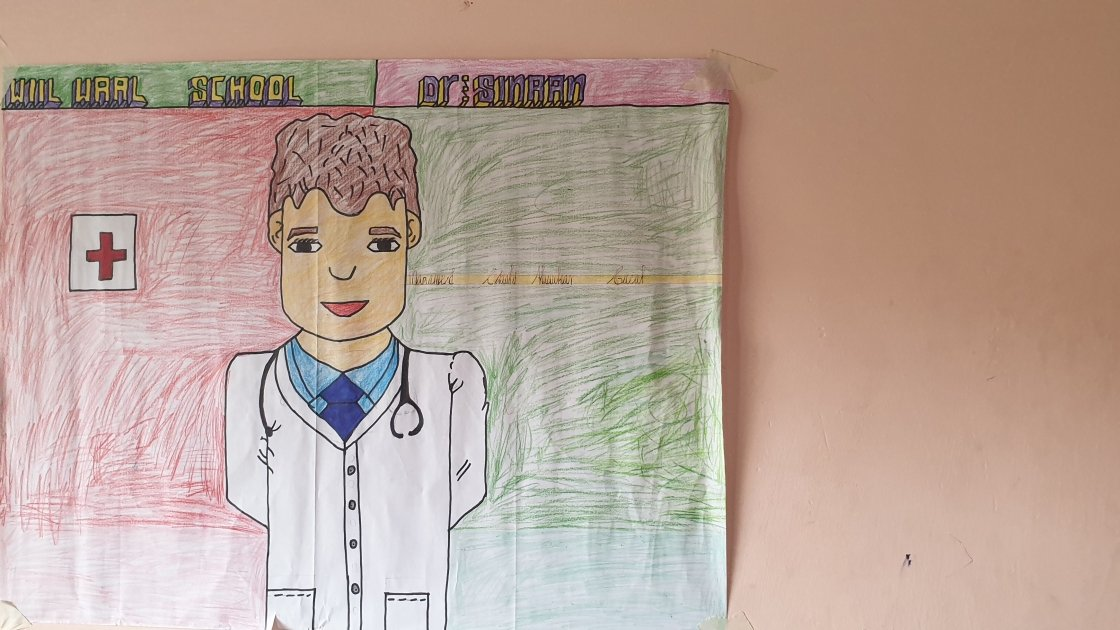 17-year-old Mubarak from Somalia draws what he wants to be when he grows up: a doctor.