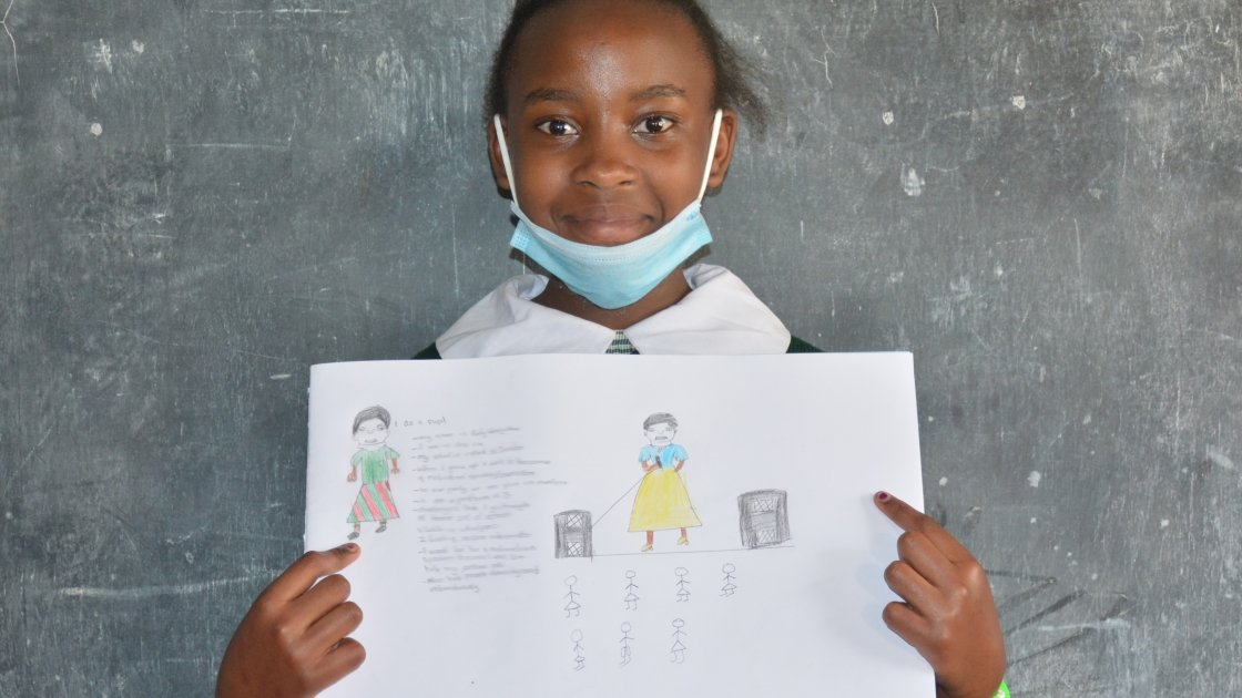 Purity from Kenya pictured here with her drawing of what she wants to be when she grows up.