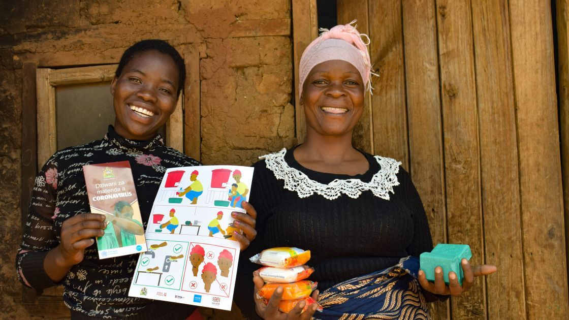 Juanita Kamwana and her daughter Jessie hold soap and Covid-19 fliers they received from Concern to help prevent the spread of Covid-19. Lilognwe, Malawi, 2020. Photo: Concern Worldwide.
