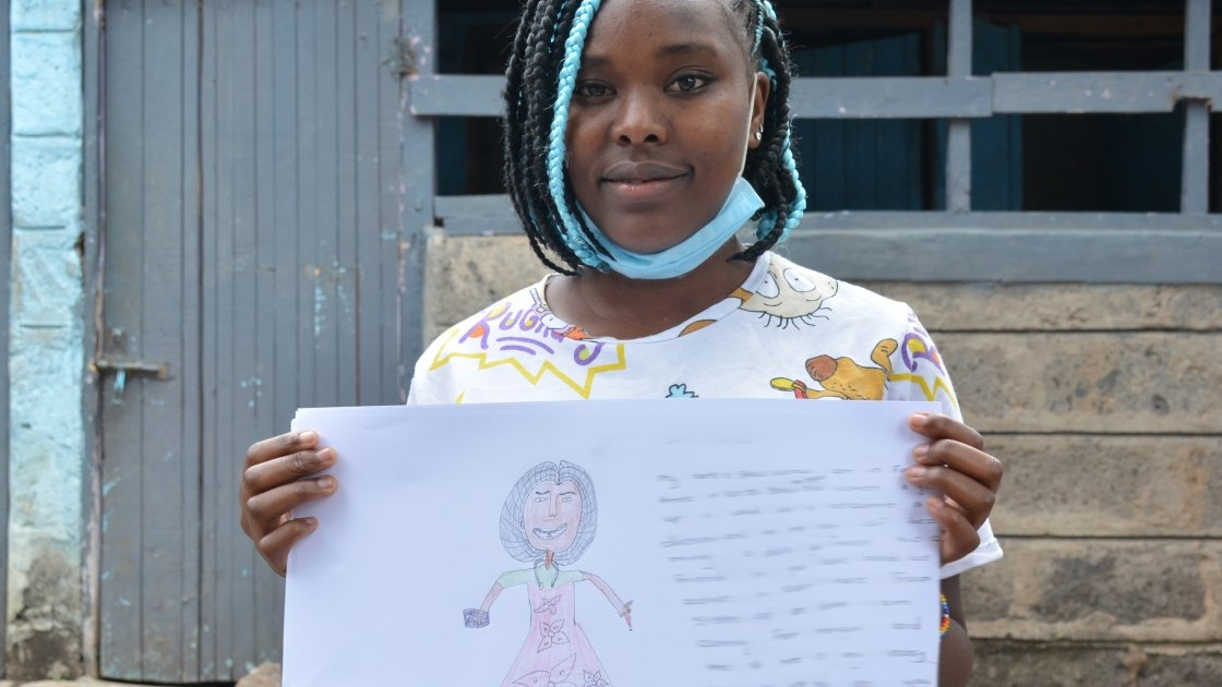 Sheila from Kenya holding her drawing of what she wants to be when she grows up.