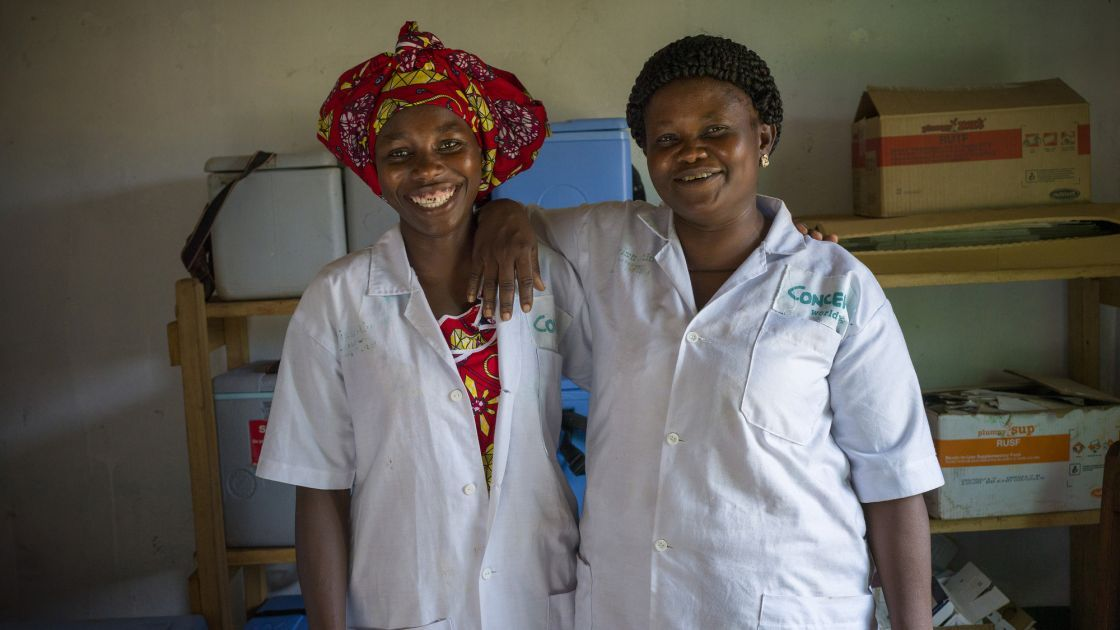 Health worker Nelly, and matron and immunisation coordinator Emielliene at Concern-supported Bekadili Health Facility. Photographer: Chris de Bode
