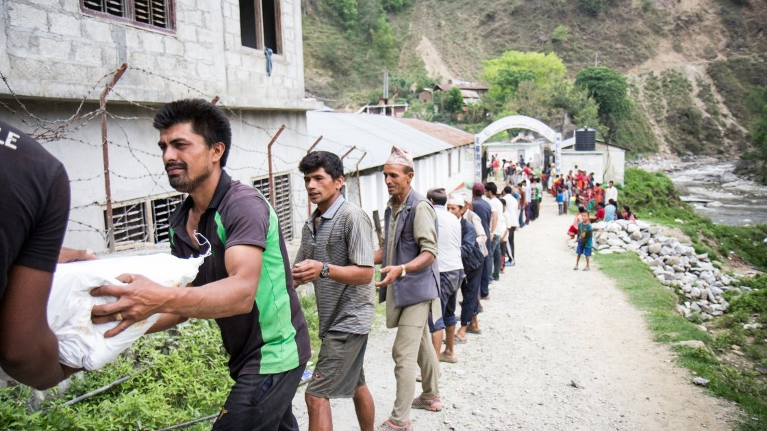 Supplies are unloaded at a Rural Reconstruction Nepal (RRN) and Concern Worldwide team distribution in Talamarang (VDC), Sindhupalchok district, Nepal. Photo by Crystal Wells, 2015.