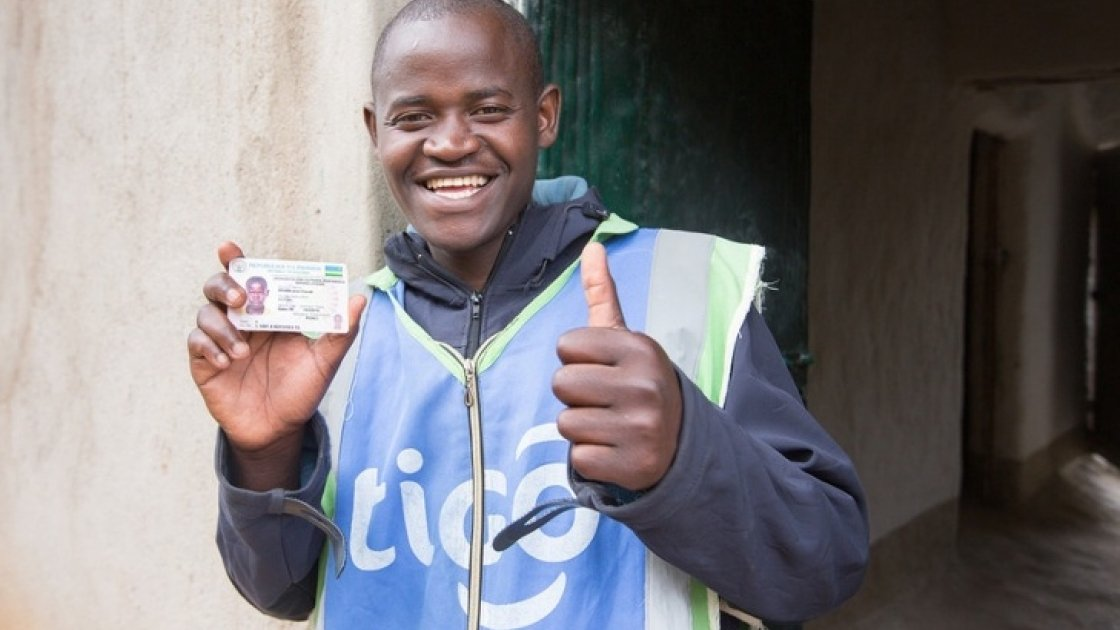 Jean Claude Minani shows off his prized motorcycle driver's licence. He participated in Concern's graduation programme in Rwanda and was able to start his own motorcycle taxi business. Photo: Robin Wyatt / Concern Worldwide, 2015