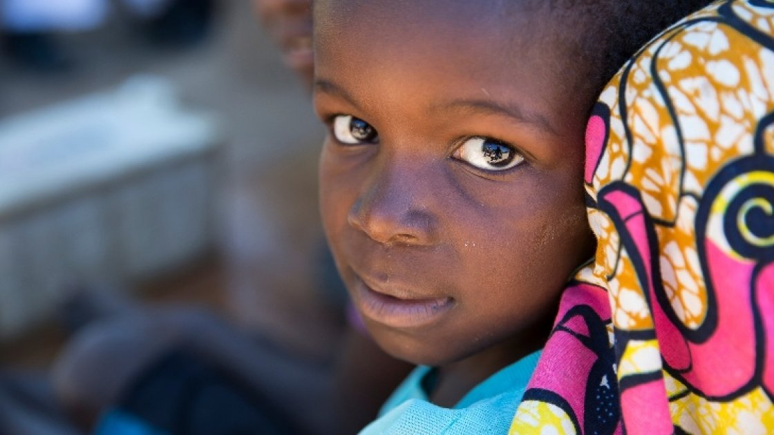 A young girl at a temporary displacement camp in North Kivu. Photo: Kieran McConville