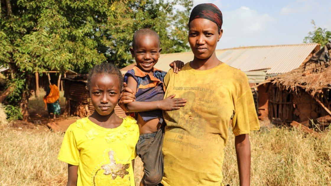 Nasino Asuran (20) is six months pregnant with her third child. Pictured here with her daughter Nangiro and son Sampson, the family are malnourished and have not eaten all day, they normally eats boiled maize once a day. Leyai Village, Marsabit, Kenya.