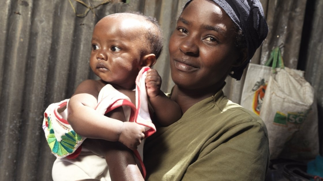 Florence Mutungi (32) with six-month-old Precious - one of her twin daughters. Florence and her husband are bringing up their five children in their one room house in one of Nairobi's largest slums, Mukuru where chronic malnutrition and stunting is a majo