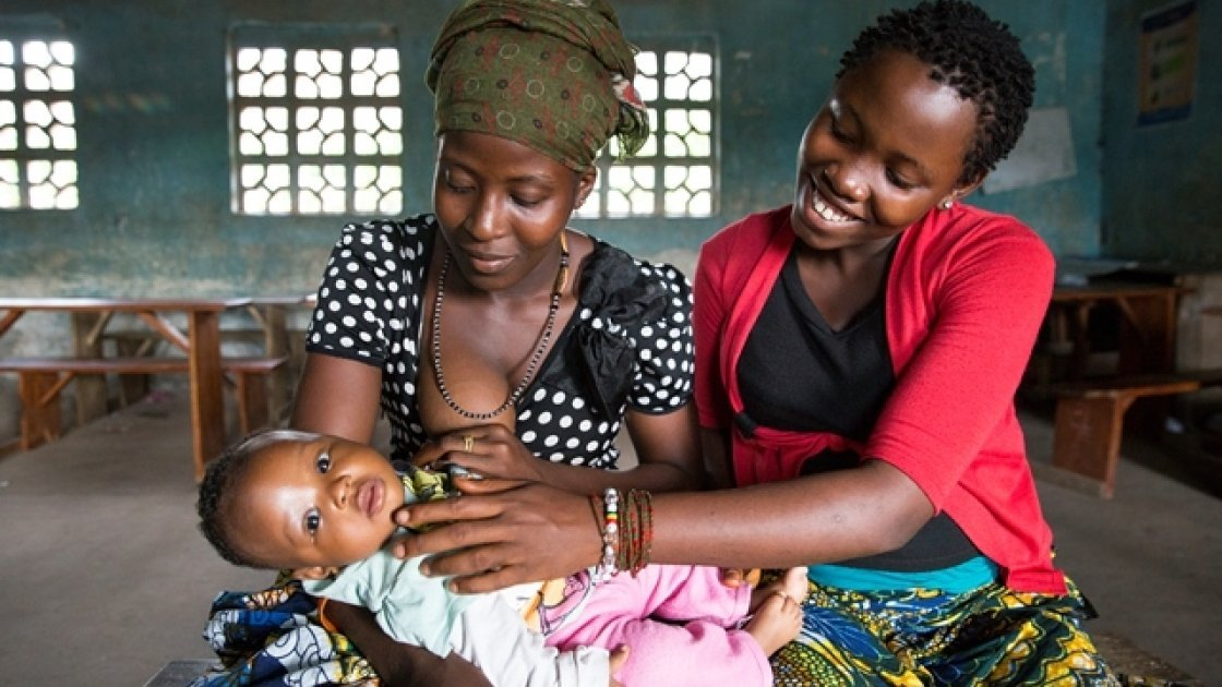 Pictured are Safiatu Kamara with her baby daughter, Awanatu and Fatumata Kabia, who is pregnant with her first child. They are attending a gathering of the Adolescent Reproductive and Sexual Health groups in the town of Mapaki. Photo: Ki
