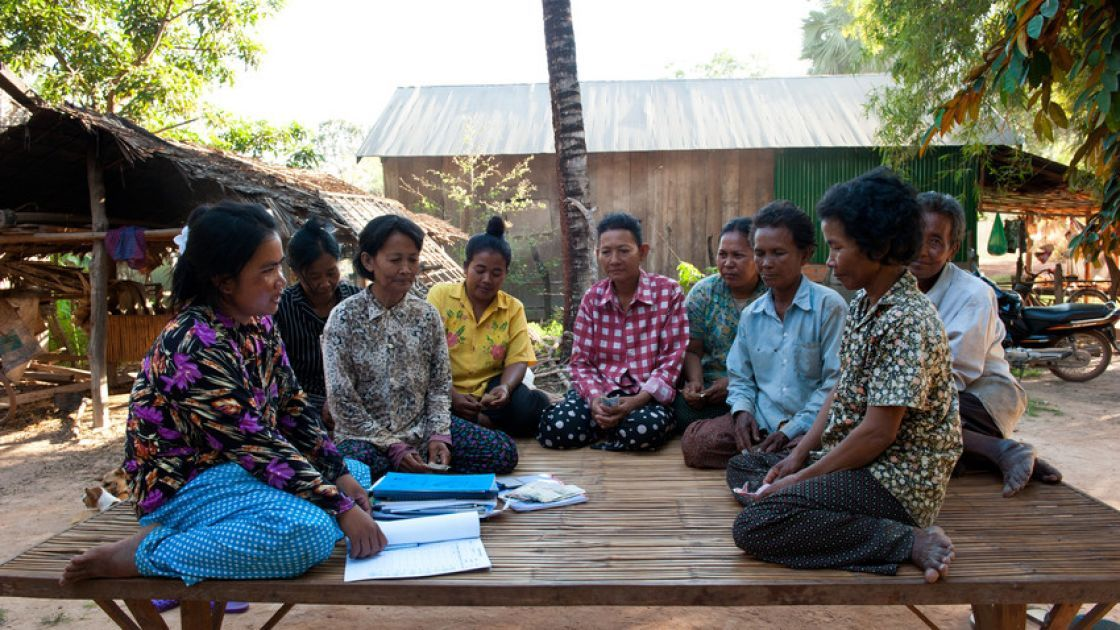 Local villagers attend a monthly Self Help Group set up by SORF (Concern's local NGO partner) in Pursat, Cambodia. Photo: Conor Wall / Concern Worldwide.