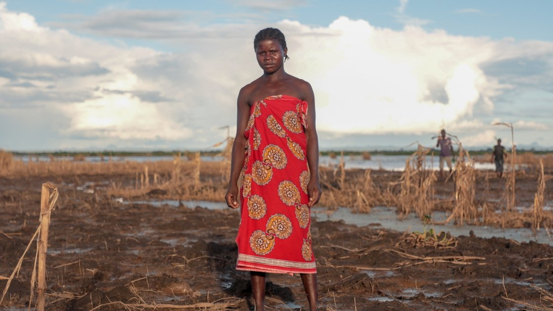 Farmer Malita (25) inspects what's left of her field after extensive flooding. The entire crop has been ruined just one month before harvest. Photo: Gavin Douglas/Concern Worldwide.
