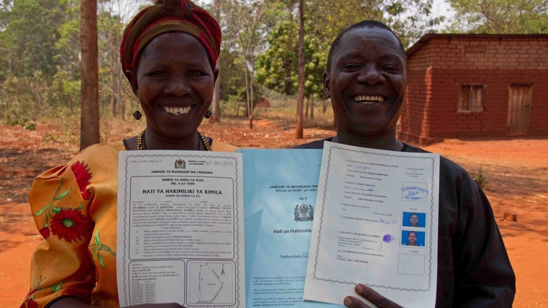 Thomas Vincent Maylinga (53) and Kaleta Sharaba Kabika (47) with their joint land certificate, Kigoma Region, Tanzania. Photo: Jennifer O'Gorman/Concern Worldwide.