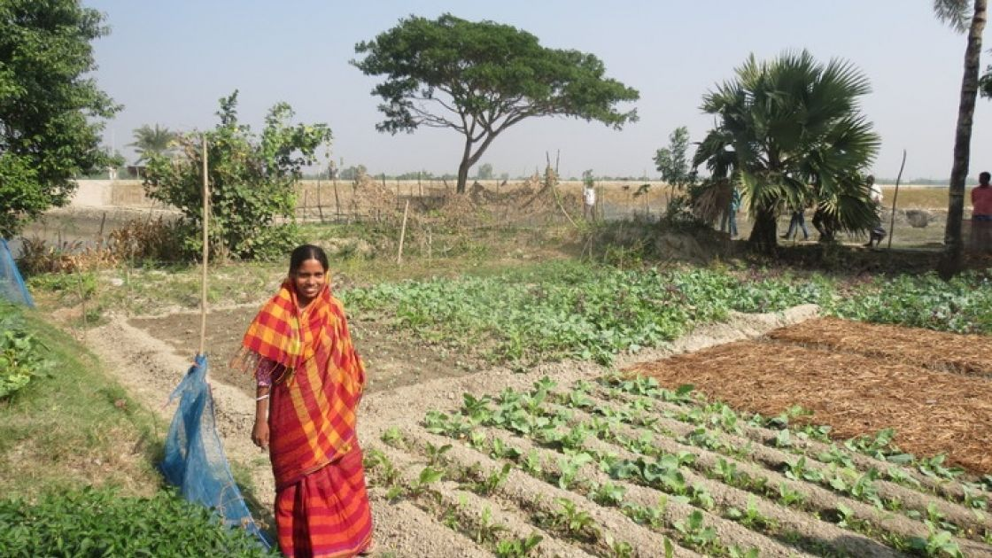 Varoti Rani stands in front of her vegetable plot. Through the costal resilience programme, she has received seeds and she is learning new techniques to help her grow a range of nutritious crops in Khulna, Bangladesh Photo: Hee Young Park /Concern Worldwi