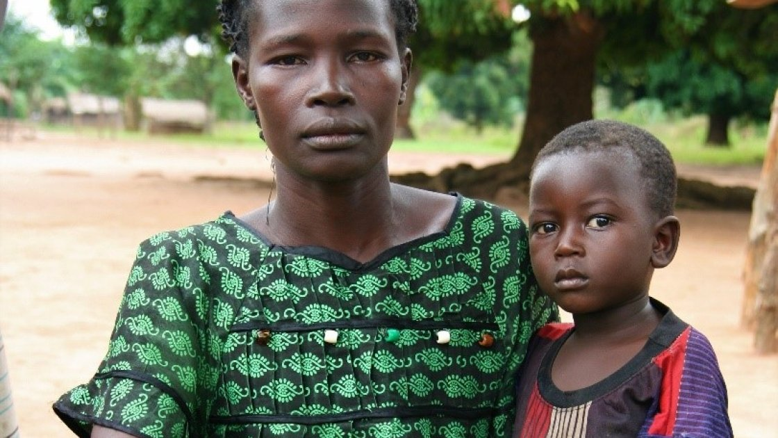 Beatrice* with her son, Robert*. Like thousands of others, Beatrice fled with her family to DRC when rebels attacked her village.