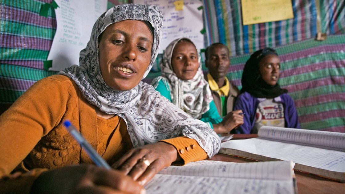 Tasam Haileselasie is the chairwoman of the Savings & Credit Co-Op in Megera in Northern Ethiopia. She tracks contributions and withdrawals of local micro-loans, which allow villagers to borrow three times their savings. Photo: Kieran McConville