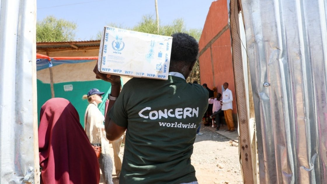 Concern Worldwide staff unloading trucks ahead of food distribution in Filtu, Somali Region, Ethiopia. Photo: Jennifer Nolan/ Concern Worldwide