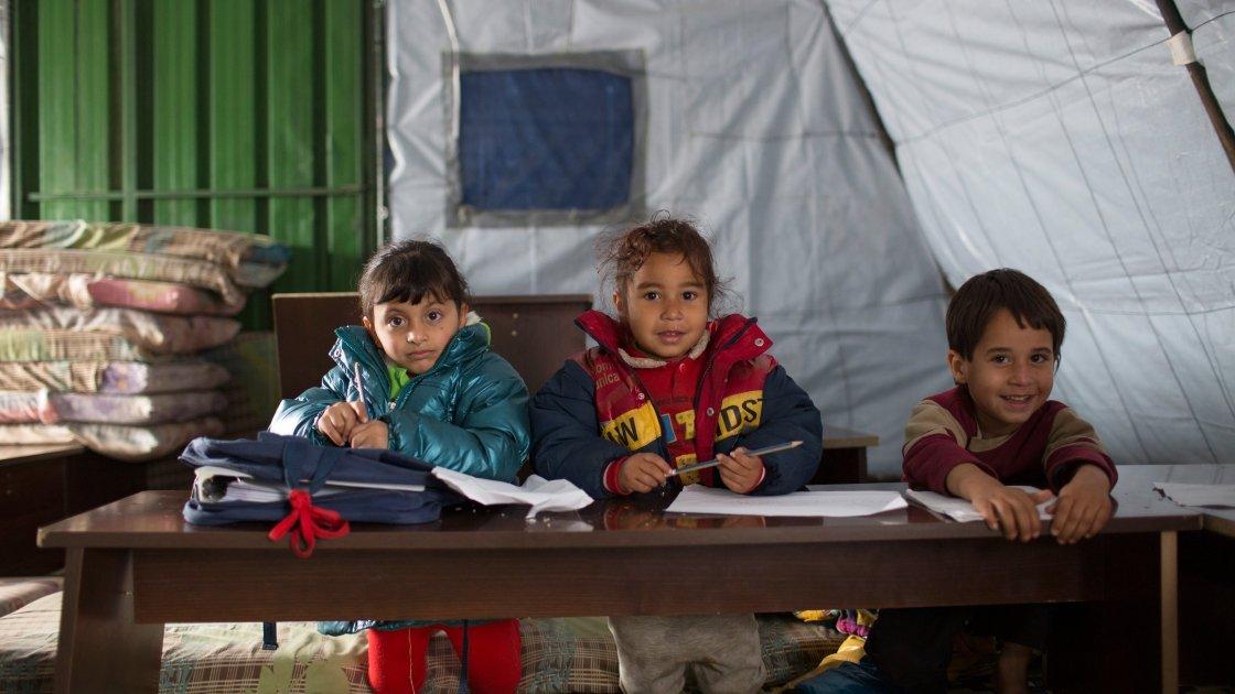 Syrian refugee children in a non-formal education program at an informal tented settlement in Mohamara, near Halba, in Akkar, north of Lebanon Photographer: Dalia Khamissy