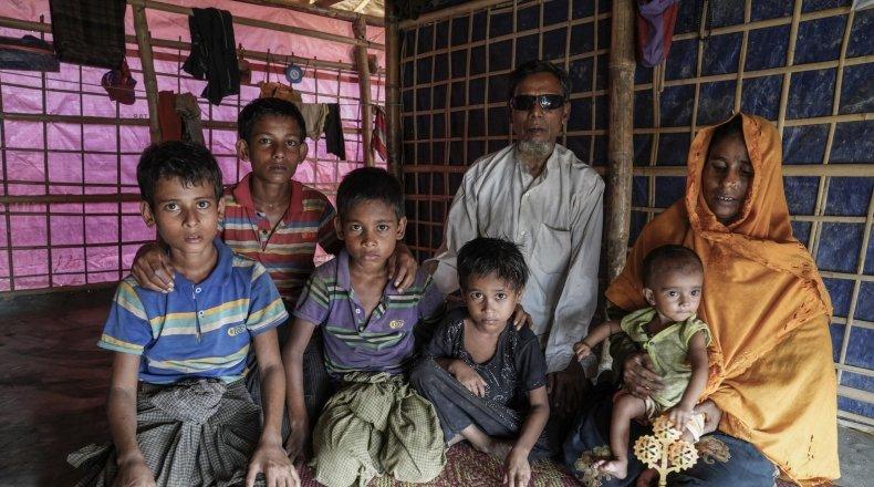 Shofika* along with her children including Laila* Kutupalong camp. Photo: Abir Abdullah/Concern Worldwide