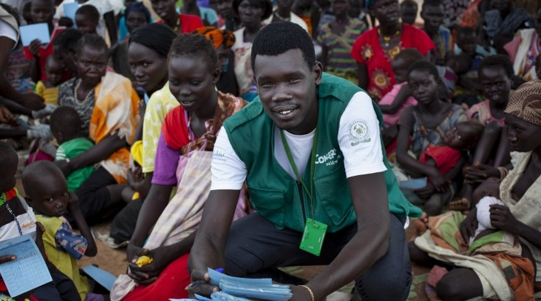 The community gathers for a Concern Worldwide Nutrition clinic at a health facility in a rural area of Aweil, South Sudan. Concern Nutrition Assistant Simon is pictured leading an educational session. Photo: Abbie Trayler-Smith