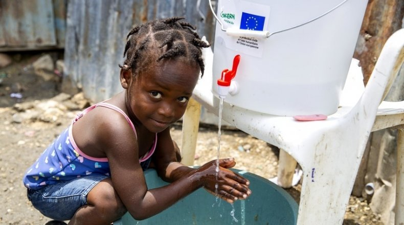 Cherica (2) washes her hands in front of her grandmother's home in Cite Soleil, a district of Port-au-Prince, Haiti. Photo: Dieu Nalio Chery/ Concern Worldwide