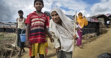 Moburak (not his real name), 8 leads his grandmother Nur (not her real name) through Moynadhona refugee camp in Cox's Bazar, Bangladesh.