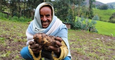 Concern-supported farmer Ahimed Ali Mahamed happily shows off potato crop produce, Ethiopia Photo: Jennifer Nolan