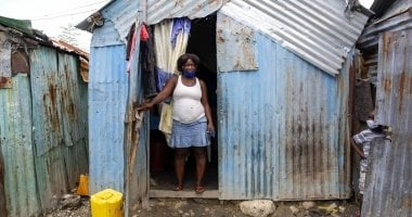 Louismene pictured outside the home she shares with her children four children in Cite Soleil slum, a district of Port-au-Prince, Haiti. Photo: Dieu Nalio Chery