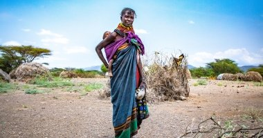 Atiir collects firewood every day in northern Kenyato make money. Drought has made it her only means of survival. Photo: Gavin Douglas