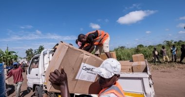 Workers unload kitchen kits from a truck at a distribution in Ndeja, Mozambique, which was hard hit by cyclone Idai in March 2019. Photo: Tommy Trenchard / Concern Worldwide.