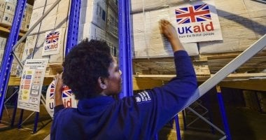 A woman prepares to send a shipment of suppoprt provided by UK aid