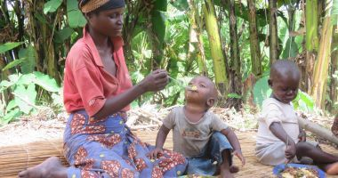 A mother feeds her baby with a balanced, nutritious meal