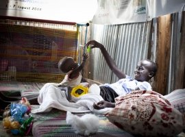 Dehlia* with her sister Koaloch* hang out in the mother and baby room in the Concern Nutrition Clinic in a POC in Juba, South Sudan. Photo: Abbie Trayler-Smith