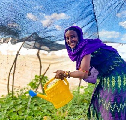 Sori, in her kitchen garden in Marsabit county, Kenya, watering her plants. Photo: Jennifer Nolan / Concern Worldwide / Kenya