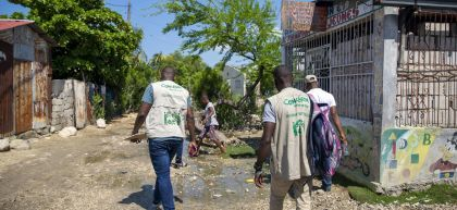 Concern staff arrive for a workshop on making liquid and solid soap in Cite Soleil slum, a district of Port-au-Prince. Photo: Dieu Nalio Chery