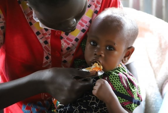 Nyalada has been given a food supplement to help her recover from malnutrition. Photo: Samir Bol / South Sudan (2020)
