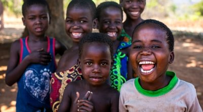 Children in Malawi gather and smile for the camera. Photo: Jennifer Nolan/Concern Worldwide.