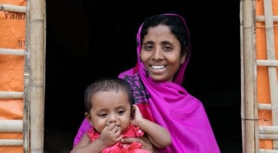 *Noor Fatima with baby daughter *Laila (9 months). Noor and her family fled violence in Myanmar and are now living in a camp in Bangladesh. They have received emergency assistance from Concern, funded by the Disasters Emergency Committee. Bangladesh. Photo: Paddy Dowling/DEC/ Concern Worldwide