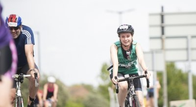 Concern supporter cycling in the AJ Bell London Triathlon