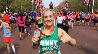 Jenny Flynn standing with her medal, having completed the London Marathon in support of Concern Worldwide UK.
