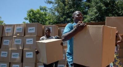 Workers load up trucks with supplies for the worst effect areas of the Nsanje Region. Photo: Gavin Douglas/ Concern Worldwide