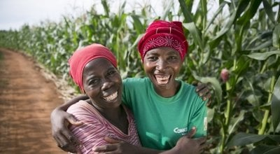 Esime Jenaia, a Lead Farmer for conservation Agriculture, at her plot in Chituke village, Mangochi, Malawi, with neighbour Esnart Kasimu. Photo: Kieran McConville / Concern Worldwide.