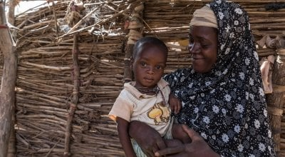 Rouaya Zahirou with her son Salouhou (1) at their home in Zardana Satourou village. Salouhou has just been admitted into Concern's nutrition programme and has started treatment for Severe Acute Malnutrition. Photo: Apsatou Bagaya / Concern Worldwide.