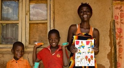 Shyreen and her sons after receiving soap from Concern's team in Malawi