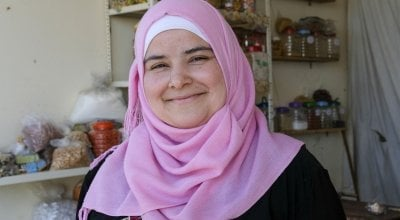Bushra runs a small grocery shop near the tented settlement where she lives. Photo: Darren Vaughan