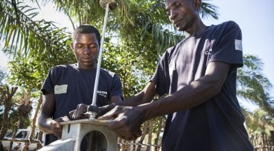 Pump technician, Ilunga Wailungabje (left), and supervisor Daviens Ngoy Wangay (right), doing maintenance work on a water pump in Katchambuyu village, Tanganyika, DRC, September 2017
