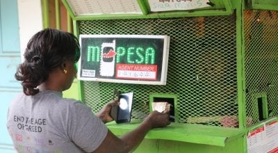 Concern Worldwide's Community Health Volunteer, Isabelle at the M-PESA kiosk, Nairobi, Kenya Picture: Jennifer Nolan