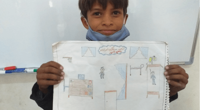 10-year-old Mohamad from Syria draws what he wants to be when he grows up: a doctor.