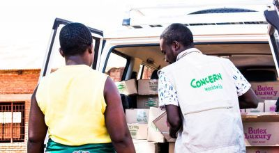 Concern employee Socrates distributing soap to Health Surveillance Assistants in Malawi. Photo: Concern Worldwide