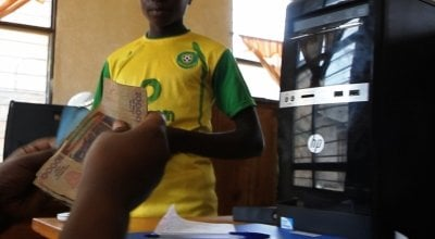 Thaddée Niyonzima, programme participant of the Graduation Programme Burundi, withdrawing this Cash Transfer of 25.000 Fbu (€12) at the post office in Mugina Commune in Cibitoke Province. Photo by Jason Basso, Video Consultant, March 2014.